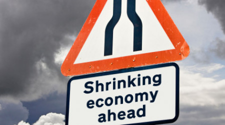 Shrinking economy, recession concept UK against a stormy sky