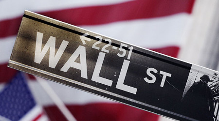 FILE - This Aug. 9, 2011 photo shows a Wall Street street sign near the New York Stock Exchange, in New York. U.S. stocks are opening slightly higher Friday, Aug. 8, 2014 as investors weigh gains in productivity against worsening geopolitical concerns. (AP Photo/Mark Lennihan, File)