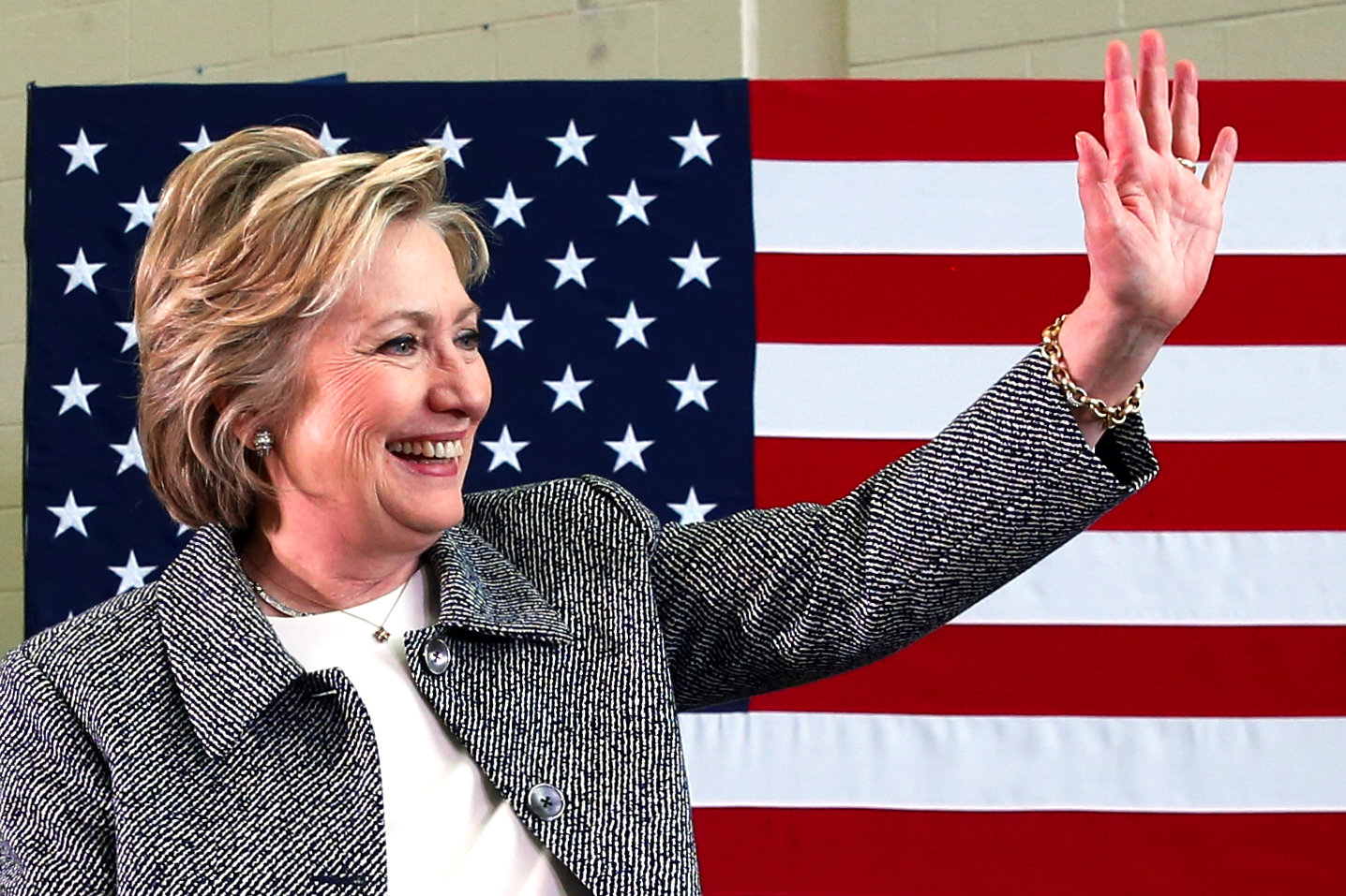 U.S. Democratic presidential candidate Hillary Clinton waves after leading a discussion on gun violence prevention in Hartford, Connecticut