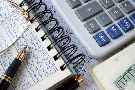 70341728 - ledger, calculator and money. business concept.